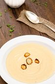 picture of parsnips  - Parsnips cream soup with roasted parsnips in a white plate - JPG