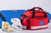 foto of stretcher  - Rescue bag cervical collars and stretcher on white background - JPG
