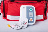 stock photo of defibrillator  - Automated External Defibrillator and rescue bag horizontal - JPG