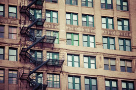 picture of brownstone  - Fire escape on an old building in USA - JPG
