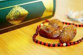 foto of namaz  - Date palm with quran for greeting ramadan kareem - JPG