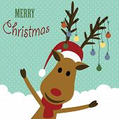 foto of cute  - Cute christmas card with reindeer and christmas light - JPG