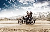 picture of biker  - Active couple riding on the motorbike - JPG