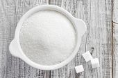 picture of sugar  - Sugar in a bowl on a table - JPG