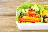 stock photo of lunch box  - Tasty vegetarian food in plastic box on wooden table - JPG