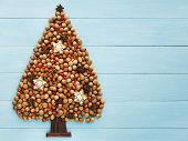 image of hazelnut tree  - Christmas tree made of nuts cinnamon and anise - JPG