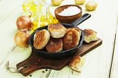 foto of patty-cake  - Patties with potatoes in a cast iron frying pan - JPG