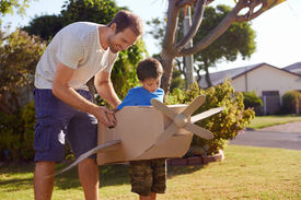 image of aeroplan  - son and dad playing with toy aeroplane in the garden at home having fun together and smiling - JPG