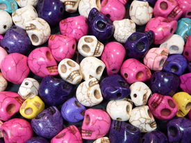pic of skull cross bones  - A Pile of colorful smiling skull beads - JPG