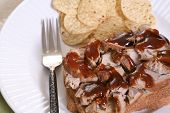 image of baps  - Pulled pork sandwich with barbecue sauce and chips - JPG