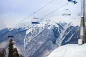 foto of caucus  - Ski chairlift with mountain on background on winter resort in Krasnaya polyana - JPG