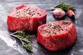picture of meats  - Raw fresh marbled meat Steak and seasonings on dark marble background close - JPG