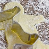 pic of cookie  - baking cookies with cookie makers on wooden table - JPG
