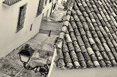 stock photo of costa blanca  - High angle take of a small street in Altea old town Costa Blanca Spain - JPG