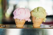 picture of jimmy  - Two ice cream corns filled with pistachio and strawberry flavors - JPG