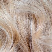 stock photo of hair streaks  - Wavy blonde woman hair background and texture - JPG