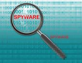 stock photo of spyware  - Close up of magnifying glass on spyware - JPG