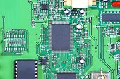 foto of transistor  - Printed computer motherboard with microcircuit close up - JPG