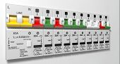 stock photo of busbar  - A row of switched off household electrical circuit breakers on a wall panel - JPG
