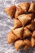 image of samosa  - Indian samosa pastry on a floured table - JPG