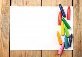 picture of montessori school  - Crayons lying on a paper - JPG