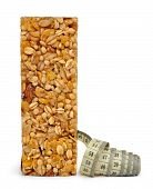 pic of roughage  - Muesli Bar with measuring tape isolated on white background - JPG