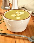 image of condiment  - A cup of organic split pea soup with condiments - JPG