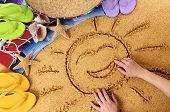 foto of sombrero  - Child drawing a smiling sun in sand on a Mexican beach with sombrero straw hat traditional serape blanket starfish and seashells - JPG