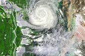 pic of typhoon  - Typhoon near crop field leaving floods and waste land - JPG