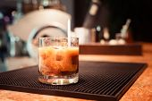 image of marsala  - White russian cocktail on the bar stand on rubber mat - JPG