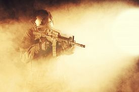 foto of police  - Spec ops police officer SWAT in the smoke and fire - JPG