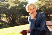 picture of retirement age  - cheerful mid age woman looking at the camera - JPG