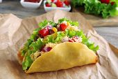 foto of tacos  - Tasty taco with vegetables on paper on table close up - JPG