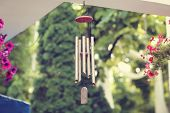 foto of chimes  - Capture of Silver and wood wind chimes - JPG