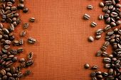 image of sackcloth  - Frame of coffee beans on color sackcloth background - JPG