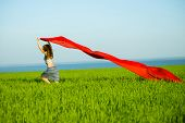 pic of rune  - Young lady runing with tissue in green field - JPG