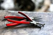 stock photo of pliers  - Pliers on table close up - JPG