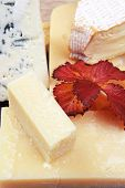 image of cheese platter  - edam parmesan and brie cheese on wooden platter over wooden table - JPG