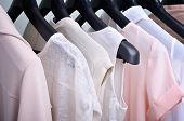foto of pastel colors  - womens clothing pastel colors hanging on the hanger verticalclothing pastel colors hanging on the hanger horizontal - JPG