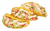 stock photo of fill  - Chicken and salad filled crispy taco shells isolated on a white background - JPG