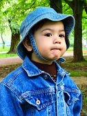 foto of panama hat  - Portrait of a baby boy in a denim jacket and a panama hat in a park at evening - JPG
