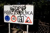 stock photo of mona lisa  - Funny road sign in Uzupis Vilnius Lithuania - JPG