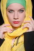 image of burka  - Serious woman wearing colourful headscarf - JPG