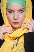 image of burqa  - Serious woman wearing colourful headscarf - JPG