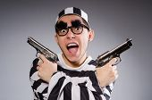 stock photo of prison uniform  - Funny prisoner with weapon isolated on gray - JPG