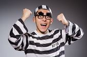 stock photo of prison uniform  - Funny prisoner isolated on gray - JPG