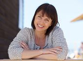 pic of close-up middle-aged woman  - Close up portrait of a confident middle aged woman smiling outside - JPG