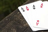 picture of balustrade  - The 4 aces cards on a wooden balustrade - JPG