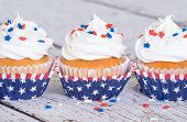 picture of sprinkling  - Cupcakes with patriotic 4th of July sprinkles on vintage background - JPG