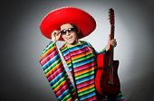 image of sombrero  - Man in red sombrero playing guitar - JPG